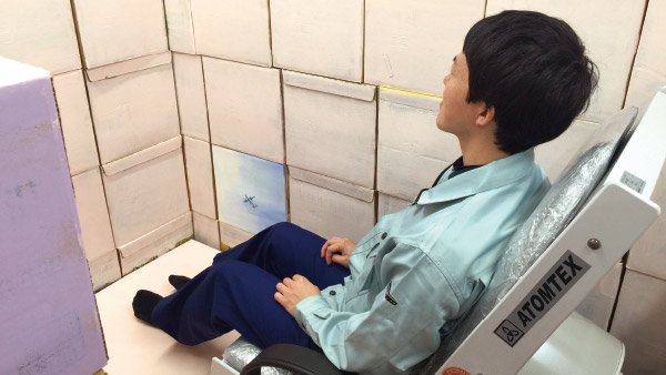 Sitting on a whole body counter to measure radiation levels in the human body ©Tarachine