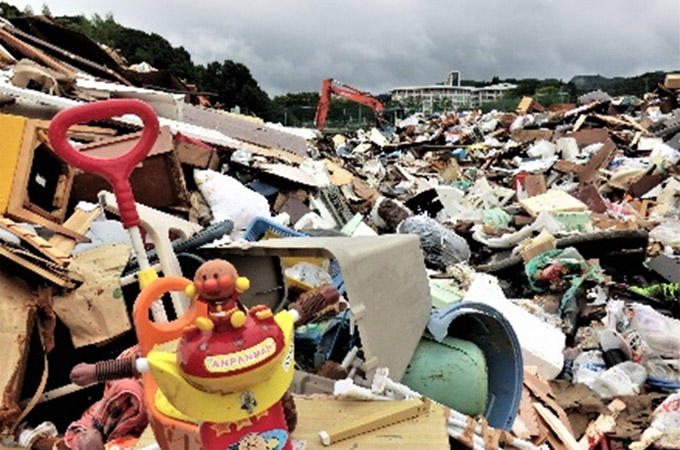 Waste collected after flooding damage, a scene repeated in the disaster affected areas. Kitagata Athletic Park, Takeo City, Saga Prefecture. Photographed on 18 August 2021 ©AAR