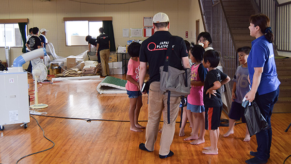 16.JPF staffs talking with children to get their needs in Nomura junior high school where they use as the evacuation shelter, Ehime, 14th July 2018 ©JPF