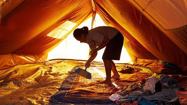 The girl cleans the tent where her family sleep/ 7th, October/ Sigi regency, Indonesia ©Lewis Inman/Arete Stories/DEC