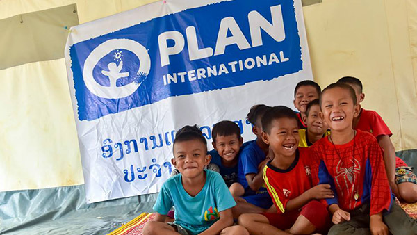 Children smiling at the child-friendly space ©Plan International
