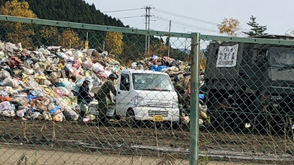 A sports field in the town of Marumori is overflowing with disaster waste ©JPF