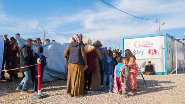 Children stand in line for a distribution at Bardarash Refugee Camp, Iraq ©IVY
