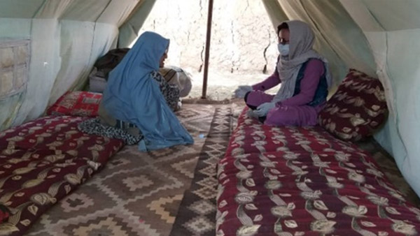 Interviewing a beneficiary about her living conditions, Afghanistan ©CWS