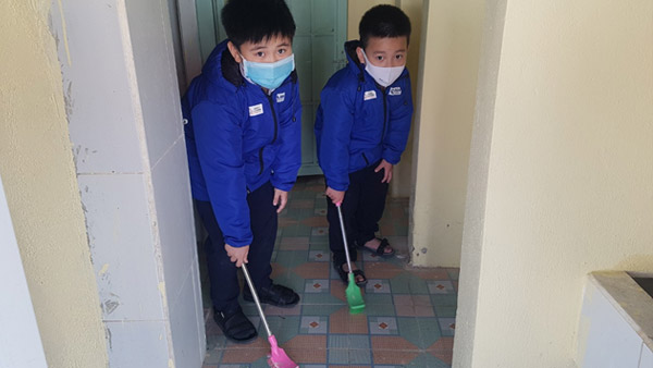 Children cleaning up the repaired facility to keep it clean ©PLAN